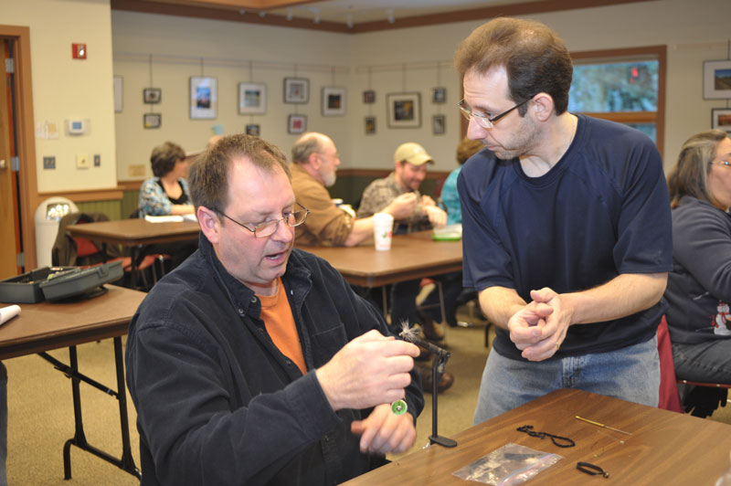 Scott Cesari (R) provides some personized help during a 2015 fly-tying class. Cesari will once again conduct fly-tying classes for the Brodhead Chapter of Trout Unlimited starting January 6, 2016.